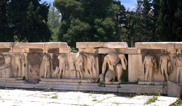 Part of the sculptures from the Roman proscenium in the Theater of Dionysus. The figure of the comic satyr, Seilenos, is in the middle
