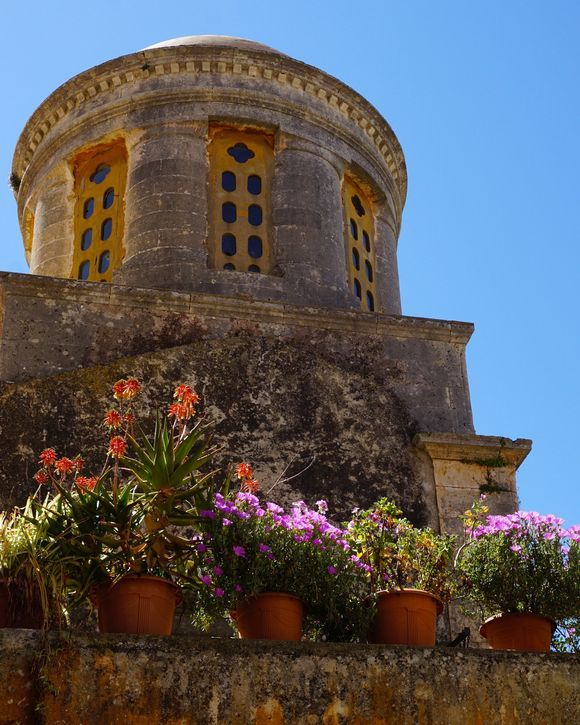 Colorful flowers and beautiful architecture are around every corner within the walls of the Agia Triada of Tzagarolon monastery.