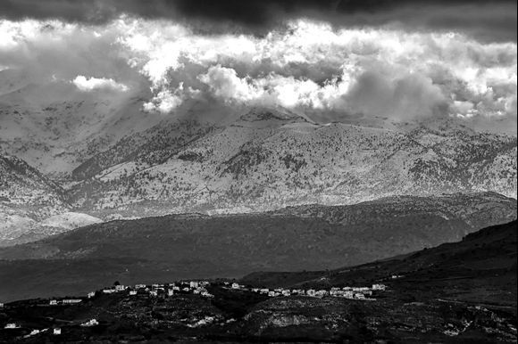The little village of Megalochari lines a hilltop in front of the White Mountains.
