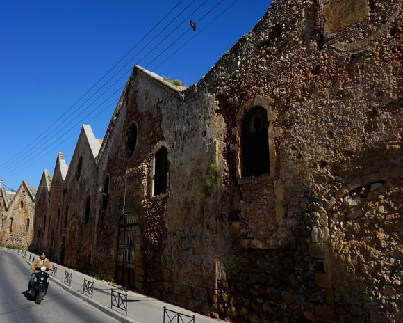 A moped rider zips along the narrow lane behind the Venetian arsenals.