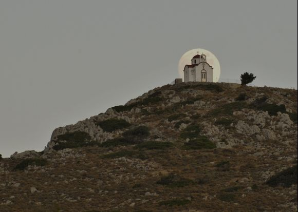 An August moon rises behind a hilltop church near Ierapetra, Crete. A great tool for helping you plan where the sun or moon is going to be and when is The Photographer\'s Ephemeris. You can find it at http://photoephemeris.com/ I had also visited the site the previous day to see when and where I wanted to be.