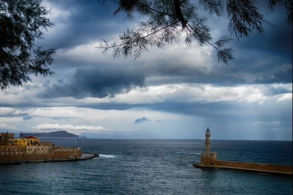 Winter scene of Chania's harbor entrance with Venetian lighthouse.