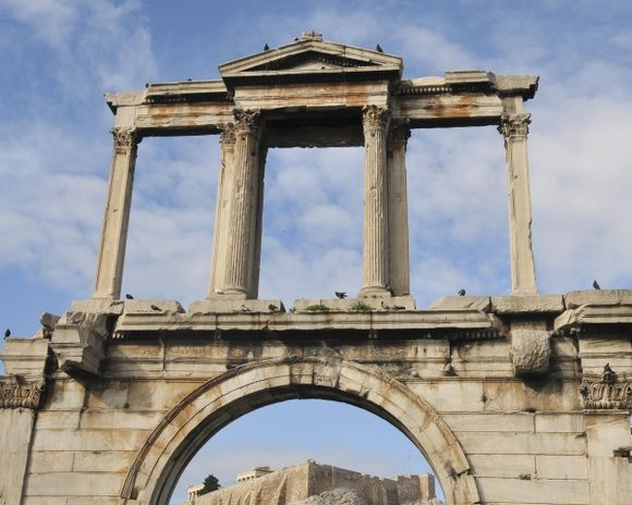 Hadrian\'s Arch at the Temple of Olympian Zeus with Acropolis Hill in the background under the arch