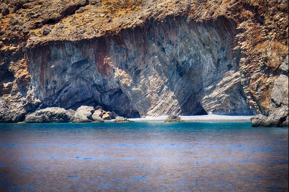 A secluded beach accessible only by water basks in its natural rugged beauty