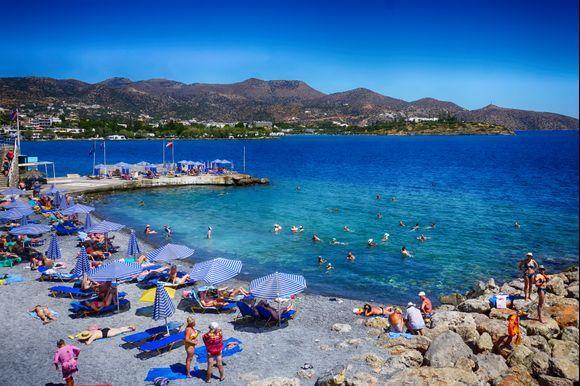 Visitors enjoy an Agios Nikolaos beach near the town's center.