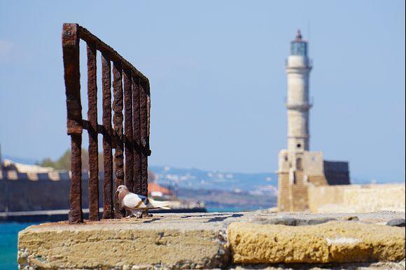 Quay wall scene of Chania's Venetian lighthouse.