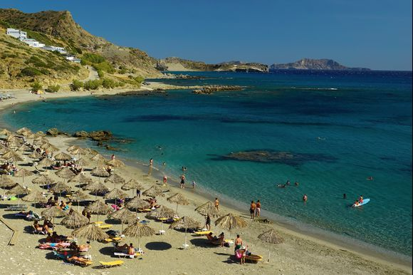 Small Triopetra beach, just east of its namesake rocks, is a busy place in mid-August but still a great place to go with plenty of space for visitors.