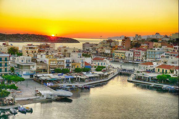 Sunrise over Agios Nikolaos with Lake Voulismeni in the foreground.