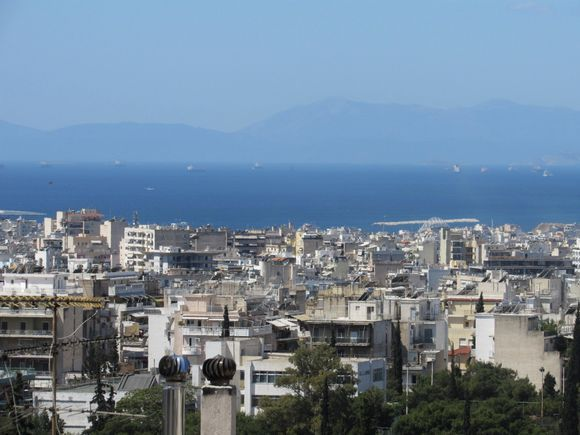 If you ask me, this is the portrait of Athens.  A concrete chaos under the bluest sky and a breath away from the sea.  I know it's a mess but it's my city and I love it.