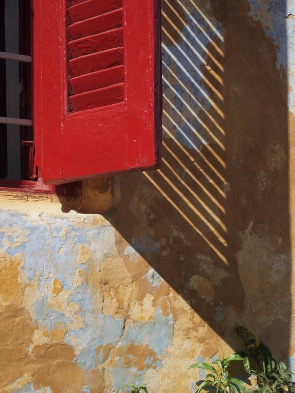 The red window shutters.