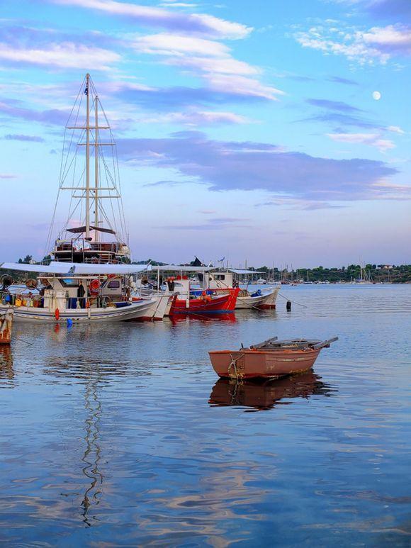 Moon over ships in Ormos Panagias port