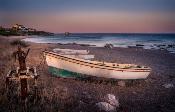 View of a boat resting on the beach in Kiotari