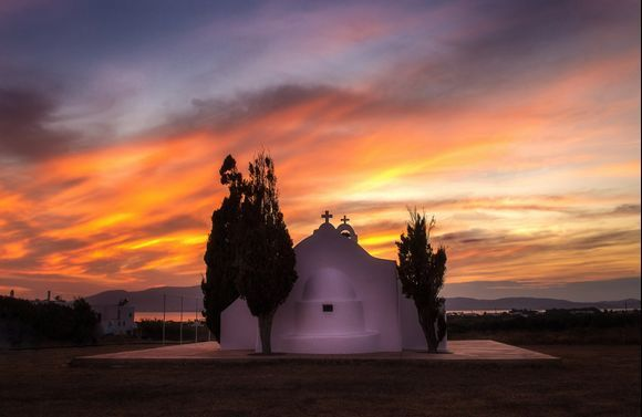 The little chapel of St. Peter's on the eastern side of Naxos, Greece, against the backdrop of a stunningly warm sunset.