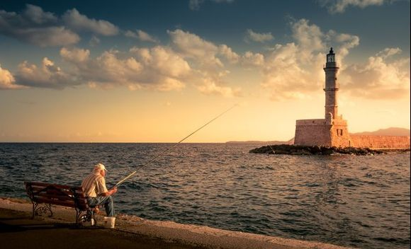 A fisherman in front of the old lighthouse