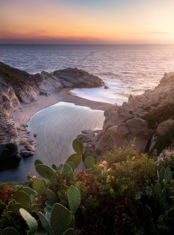 A couple enjoying a beautifully warm sunset on the fabulous Nas beach on Ikaria