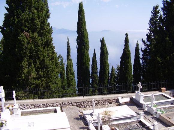 A cemetry surrounded by Cypress trees, near Exogi, Ithaca