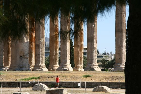 Showing majestic old temple remains compred to the size of a person
