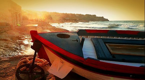 a boat has been pulled ashore, in rethymnon, because of the strong winds.