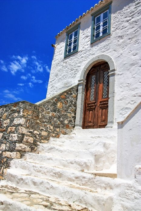 Mansion with whitewashed flight of stairs and sky