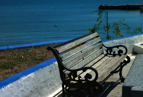 Waterfront with wooden bench, Selinia, Salamina island