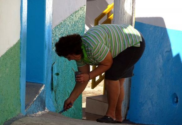 Woman painting her house