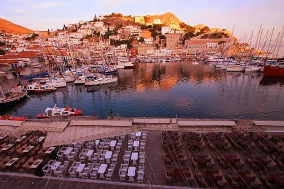 Hydra harbour at dawn with empty cafes