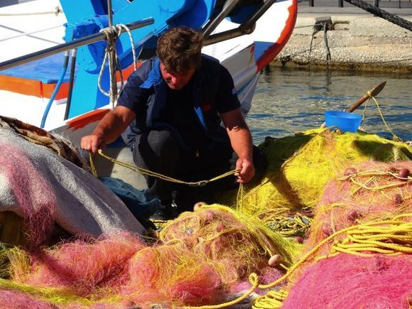 Fisherman and colorful nets