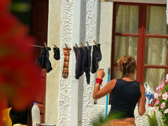 Scene with a girl and hanging laundry in Filoti