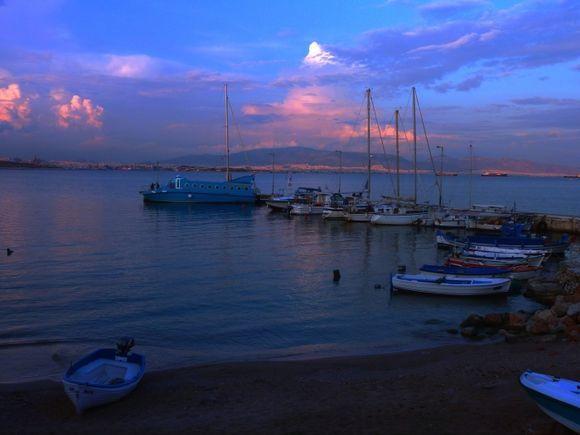 Selinia beach and boats at dusk. Salamina island, Saronic Gulf