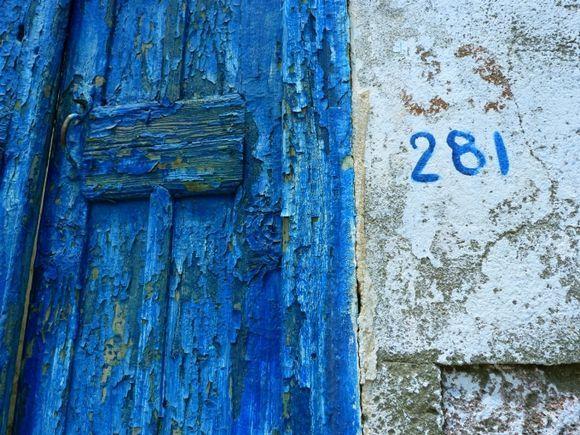 Decayed blue wooden door