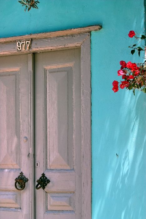 Facade with bougainvillea and blue wall, Hydra town