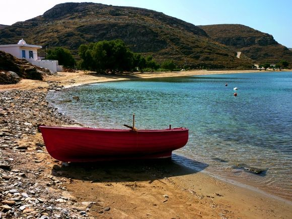 Apokrousi beach with red boat