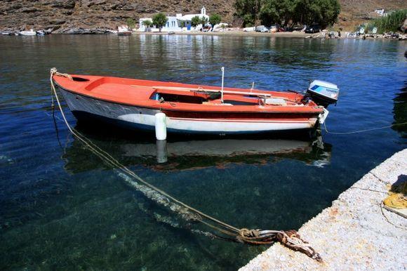 Agia Irini Bay with red fishing boat