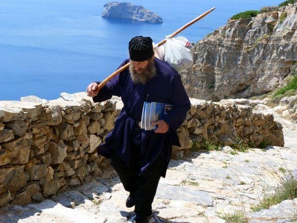 Monk climbing to the Monastery of Hozoviotissa