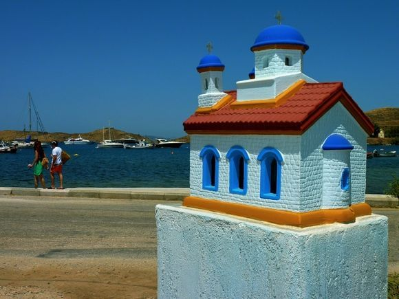 Waterfront with colourful chapel, Vourkari