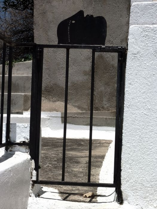 Steps and black iron gate