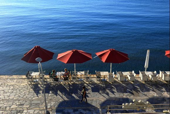 Waterfront with red umbrellas