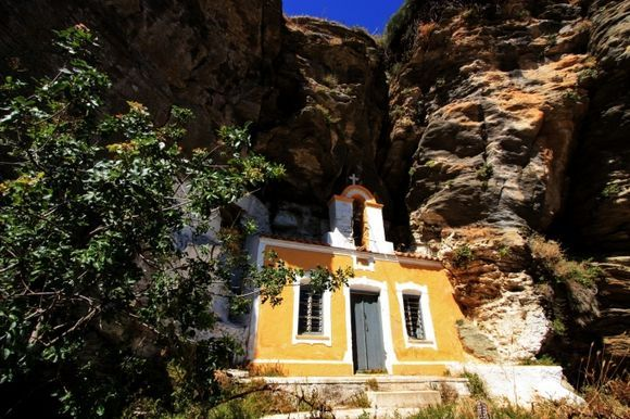 Small yellow church nested in the rocks, Ioulis