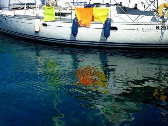 Sailboat and reflections