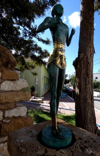 Statue of kouros in a street