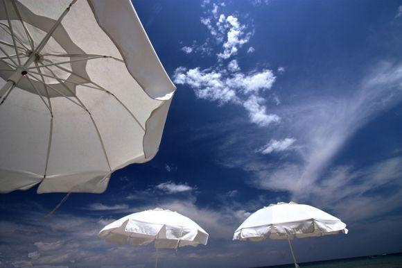Sky and umbrellas on Aghia Marina beach, Aegina island