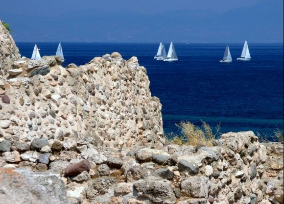 Ancient wall and sails. Kolonna site. Aegina Town