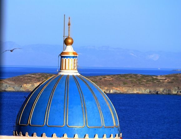 Sky with Agios Nikolaos blue dome and seagull