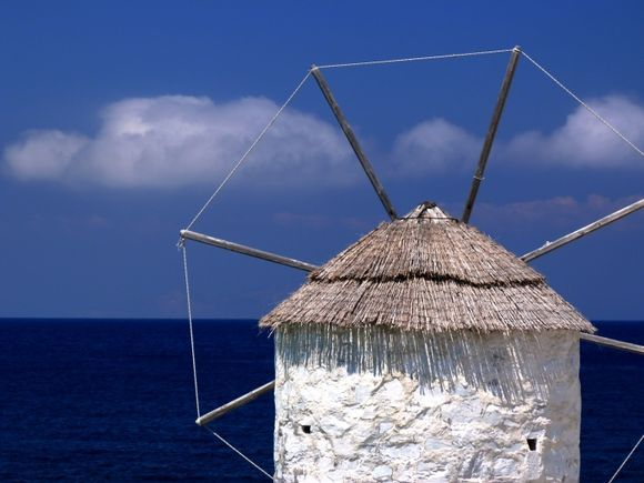 Aegiali\'s windmill with blue sky and sea