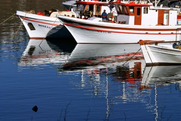 Fishing boats with reflections