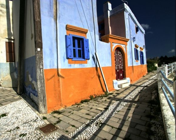 Traditional paved alley and colorful house