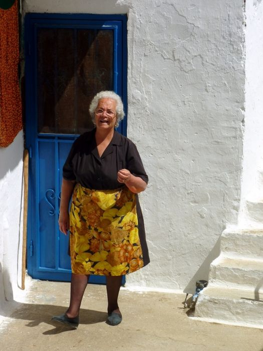 Portrait of a woman in front of her house, Koronos