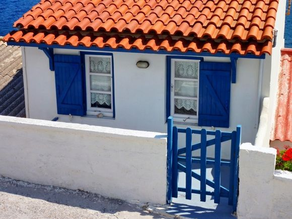 Seashore house with red tiled roof