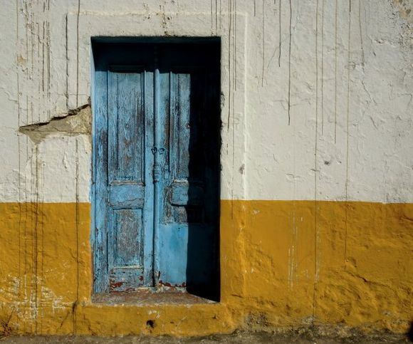 Decayed wall and blue door