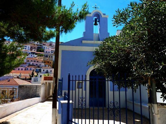 Blue church and colourful village